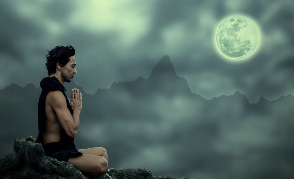 Meditating man.